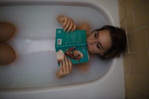 woman-tub-water-bubbles-book